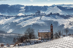 Small church and wintry hills. Stock Images