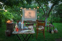 Small cinema with drinks and popcorn in the garden royalty free stock photography