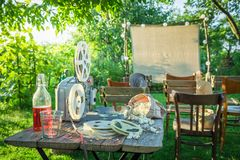 Small cinema with drinks and popcorn in summer garden Stock Photo