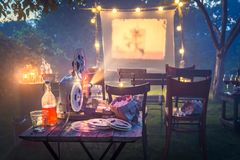 Small cinema with old analog films in the evening. Session in outside royalty free stock photo