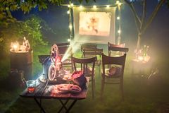Small cinema with retro projector in the garden. Session in outside Royalty Free Stock Photography
