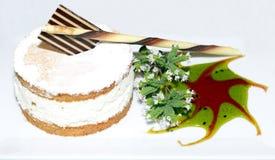 Small cinnamon bun with cream Royalty Free Stock Image