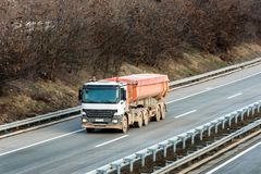 Small Cistern truck on country highway royalty free stock images
