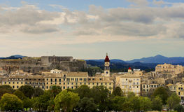 Small city panorama with mountains in a background Stock Photos