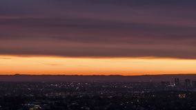 Small City silhouette at sunset timelapse stock footage
