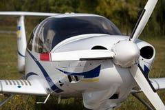Small civil plane. Small white civil plane fuselage close shot Stock Image