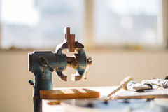 Small clamp on workbench Royalty Free Stock Images