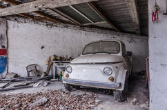 small classic car in garage Stock Photography