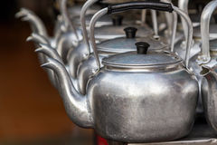 Small classic kettle in row. Royalty Free Stock Images