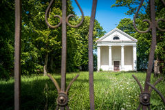 Small classicism building chapel abandoned. Small classicism chapel abandoned surrounded by green nature Royalty Free Stock Photography