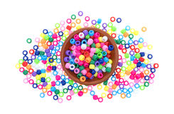 Small clay bowl filled with pony beads Stock Photography