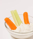 Small clear bowl of dip and vegetables. Royalty Free Stock Photos