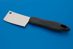 Small cleaver. Smal cleaver isolated on the blue background stock photography