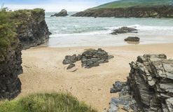 Small cliffs and beach at Trevone Bay in Cornwall stock photo