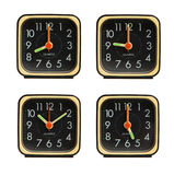 Small clocks showing various time of the day Royalty Free Stock Images