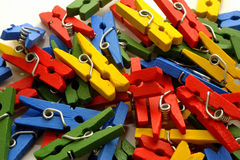 Small clothes pegs of colors Stock Photo