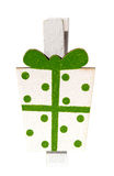 Small clothespin with a present, Christmas motifs, isolated close-up Royalty Free Stock Photo