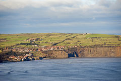 Small coastal town on the clifftops. Small english seaside town on the coast with cliffs Stock Image