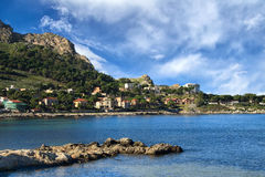 Small coastal town and high hills. Located at the seashore Stock Photography