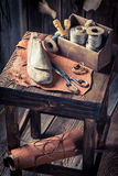 Small cobbler workshop with tools, shoes and laces stock photography