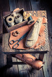 Small cobbler workshop with tools, shoes and leather Stock Photos