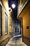 Small cobblestone alley Stock Photos