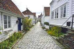 Traditional cobblestone street with wooden houses in the old town of Stavanger, Norway Royalty Free Stock Photos