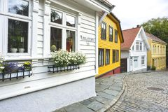 Traditional cobblestone street with wooden houses in the old town of Stavanger, Norway Stock Photo