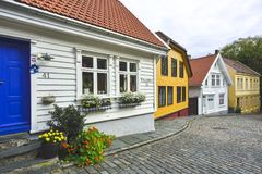 Traditional cobblestone street with wooden houses in the old town of Stavanger, Norway Stock Images