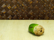 Small coconut isolated on table in weave background Royalty Free Stock Photography