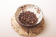 Coffee beans in a cup. White light background. Small coffee beans in a cup. White light beige background Stock Photos