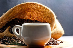 Small coffee cup and grain Stock Image