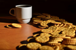 Small coffee cup and salted cracker Royalty Free Stock Images