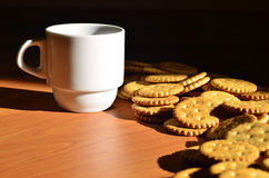 Small coffee cup and salted cracker Stock Image