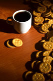 Small coffee cup and salted cracker Royalty Free Stock Image
