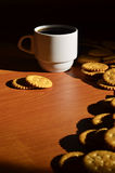 Small coffee cup and salted cracker Royalty Free Stock Photos