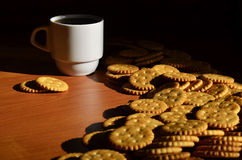 Small coffee cup and salted cracker Stock Photo