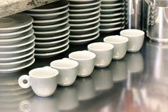 Small coffee cups on a metal cafeteria counter Royalty Free Stock Photos