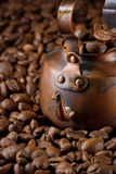 Small coffee pot with coffee beans Stock Photos