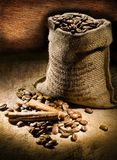 Small coffee sack vith cinnamon and copy space Royalty Free Stock Image