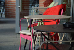 Small coffee tables and chairs in an outdoor cafe. Outdoor coffee tables photographed in Berlin, Germany. Cosy little restaurant with seating outside on the Royalty Free Stock Image