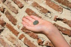 A small coin in 50 Bulgarian stotinki. A small coin in 50 Bulgarian stotinki, lies on the child`s palm Stock Photography