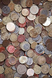 Small coins of different European countries. Vertical photo background with small coins of different European countries royalty free stock photo