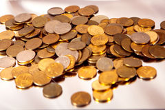 Small coins scattered. On the table Stock Photography
