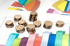 Small coins and schedule growth. Stock Photos
