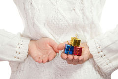 Small color christmas gifts in palms of hands Royalty Free Stock Photo
