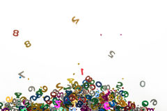 Small color numbers confetti on white Stock Image