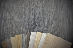 Small color sample boards. toned image. Samples of laminate and vinyl floor tile on wooden Background for new constuction or renovate building Stock Image