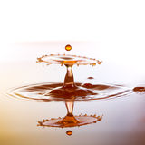 A small color waterdrops fall on water surface and. Splashing water drops on color background.Color waterdrops collide each other Royalty Free Stock Photos