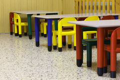 Small colored benches and seats of a class of a preschool. Without kids royalty free stock photos